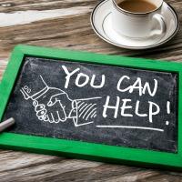you can help handwritten on blackboard